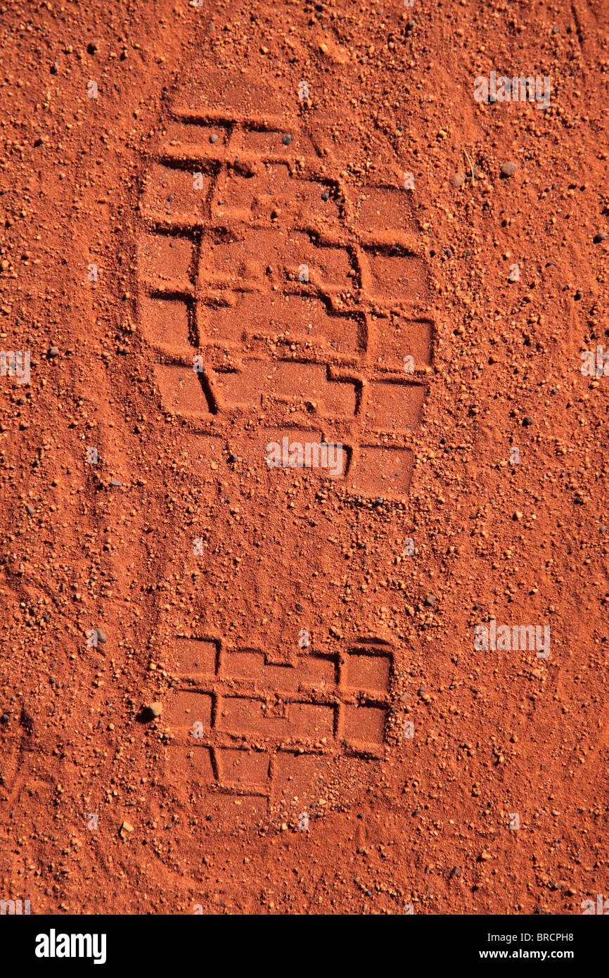 Footprint in the typical red sand desert of Central Australia Stock Photo