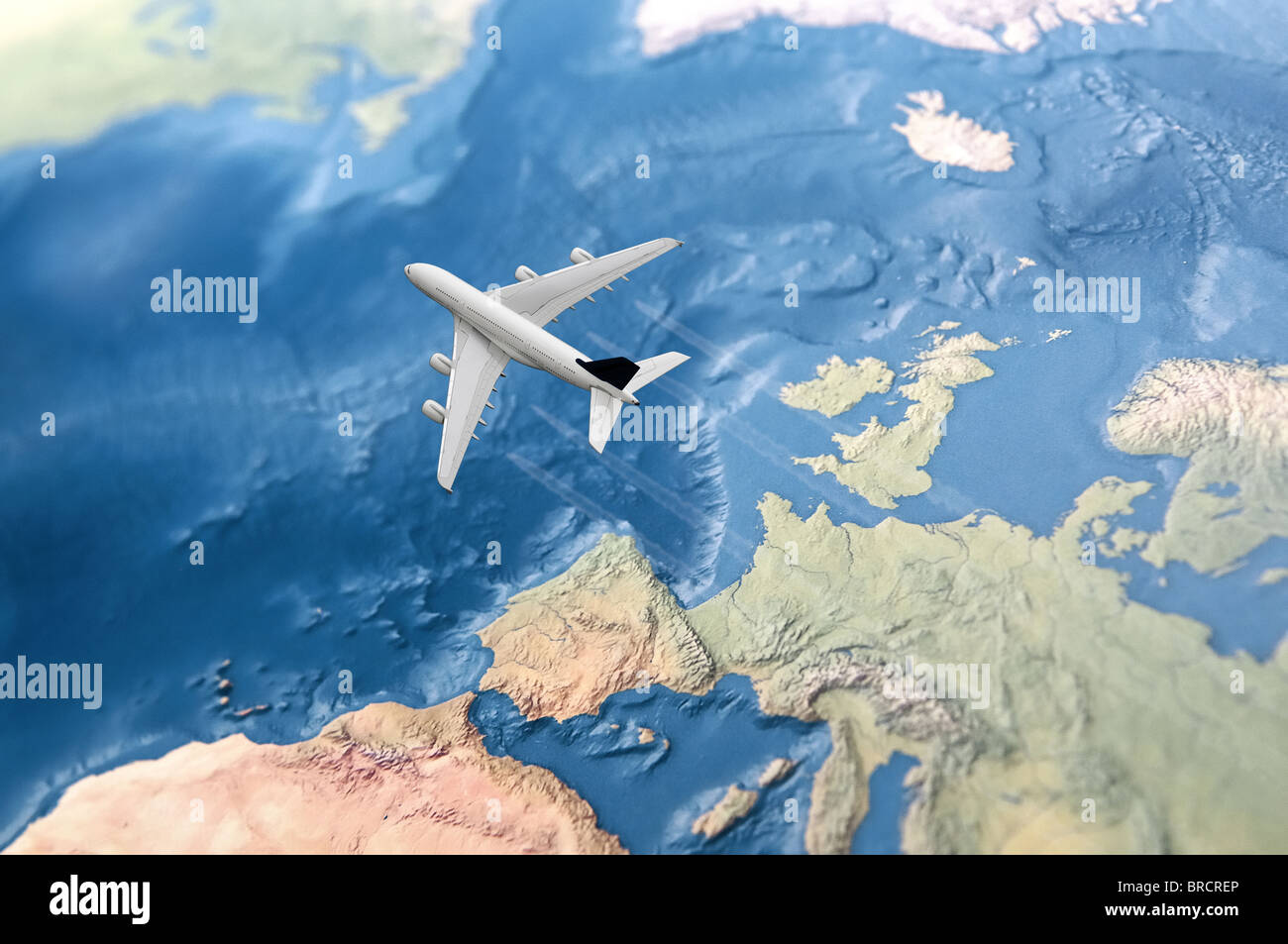 White Civil Airplane over the Atlantic ocean flying from Europe to the USA - Stock Image