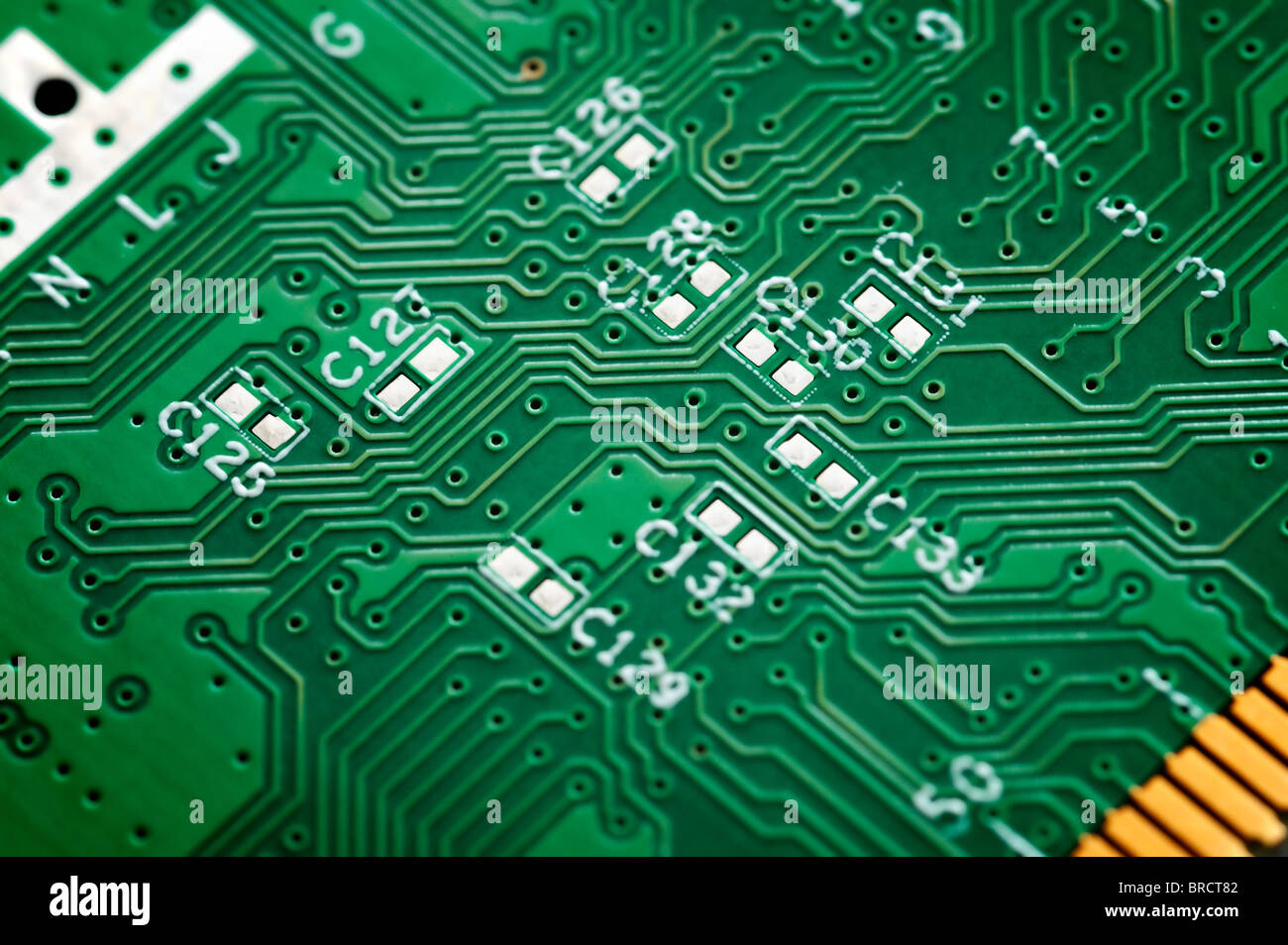 Close up of s green circuit board without components. - Stock Image