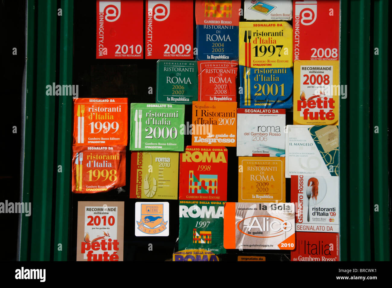 Good food type award stickers in restaurant window in rome italy