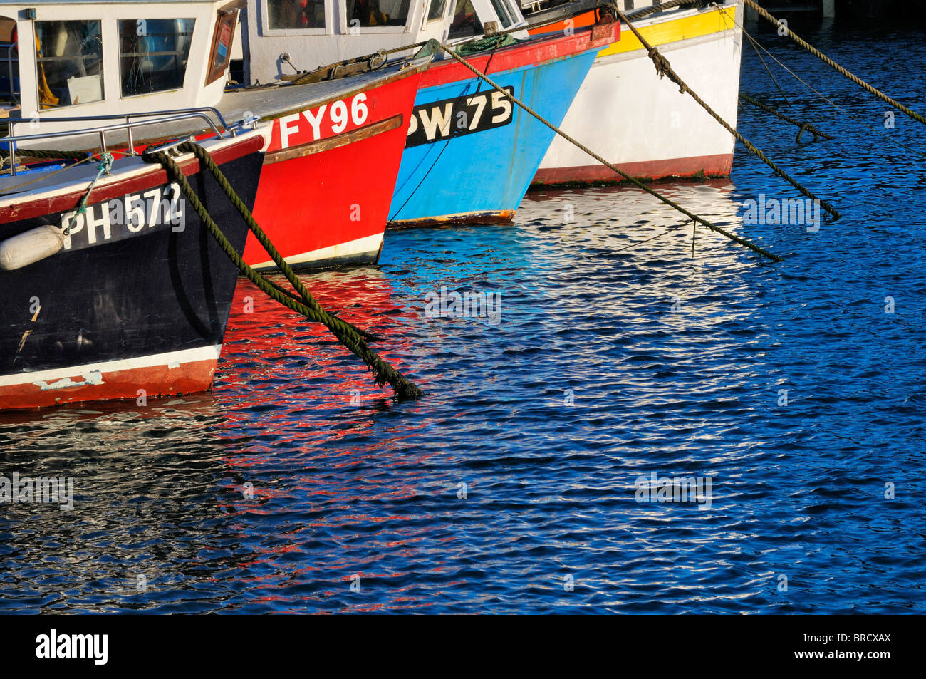 Colourful fishing boats in harbour - Stock Image