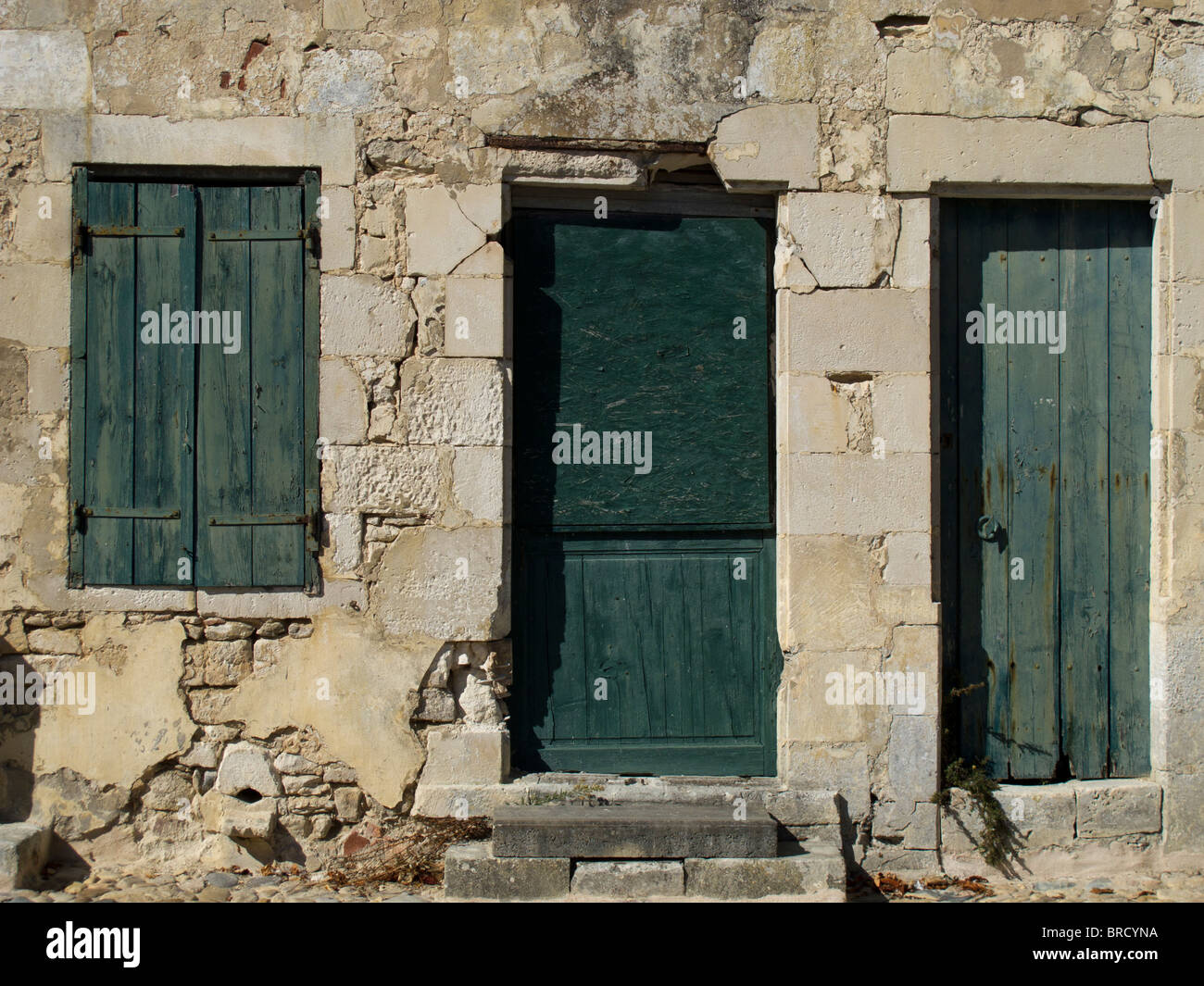 A disused house with closed shutters in St Martin de Re on the Ile de Re, France - Stock Image