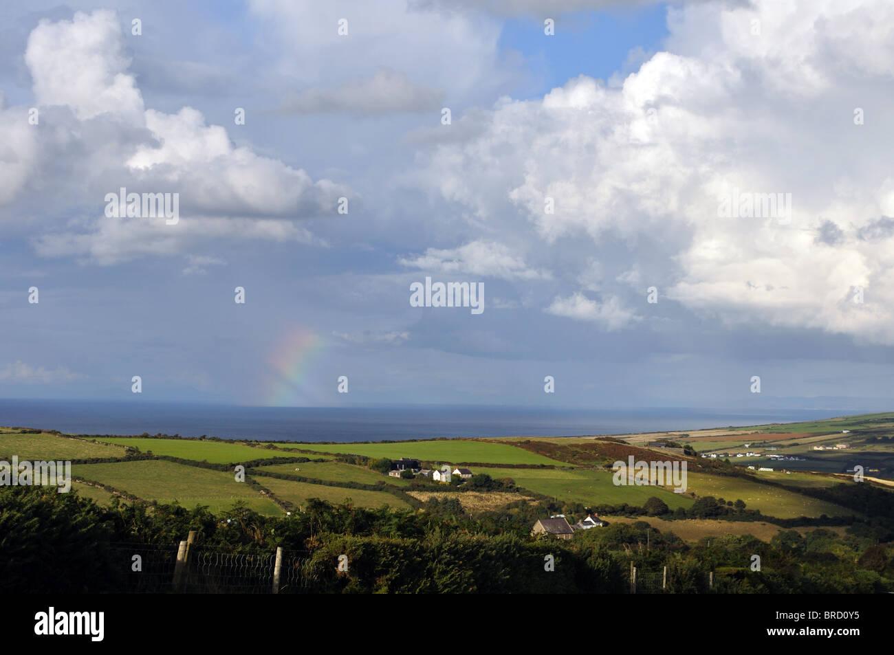 Rainbow over Cardigan Bay, St Dogmaels, Pembrokeshire, Wales, United Kingdom - Stock Image