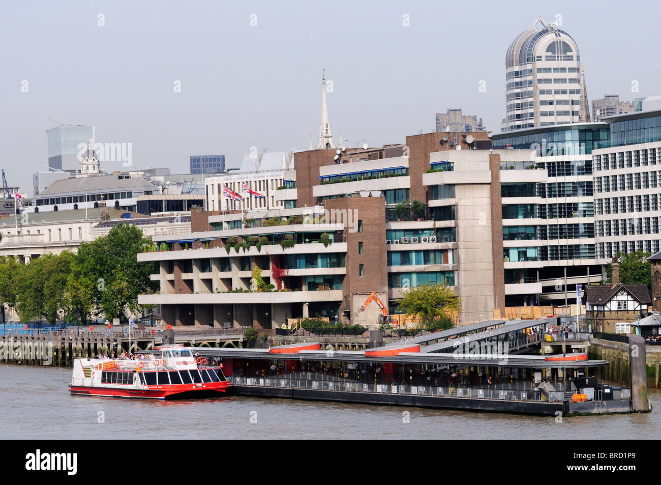 A City Cruises tourist sightseeing boat at Tower Pier, London, England, Uk - Stock Image