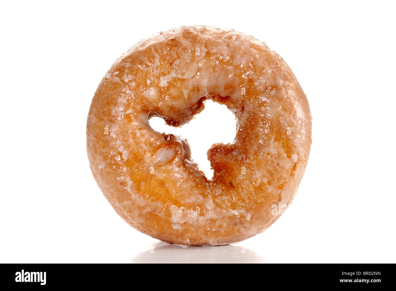 Close-up image of a sugar glazed donut studio isolated on a white background - Stock Image