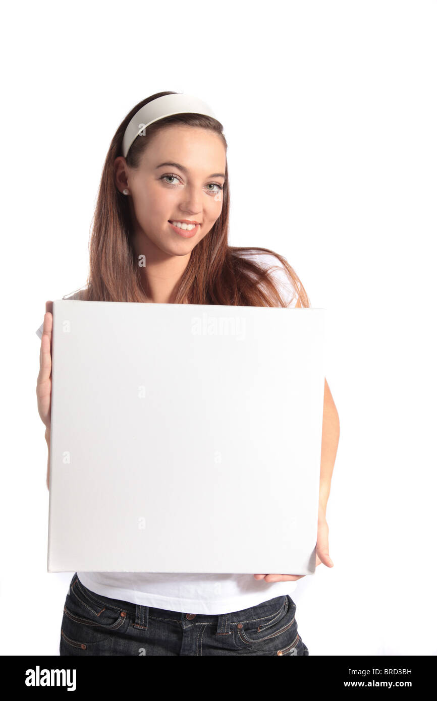 An attractive young woman holding a white board. All isolated on white background. - Stock Image