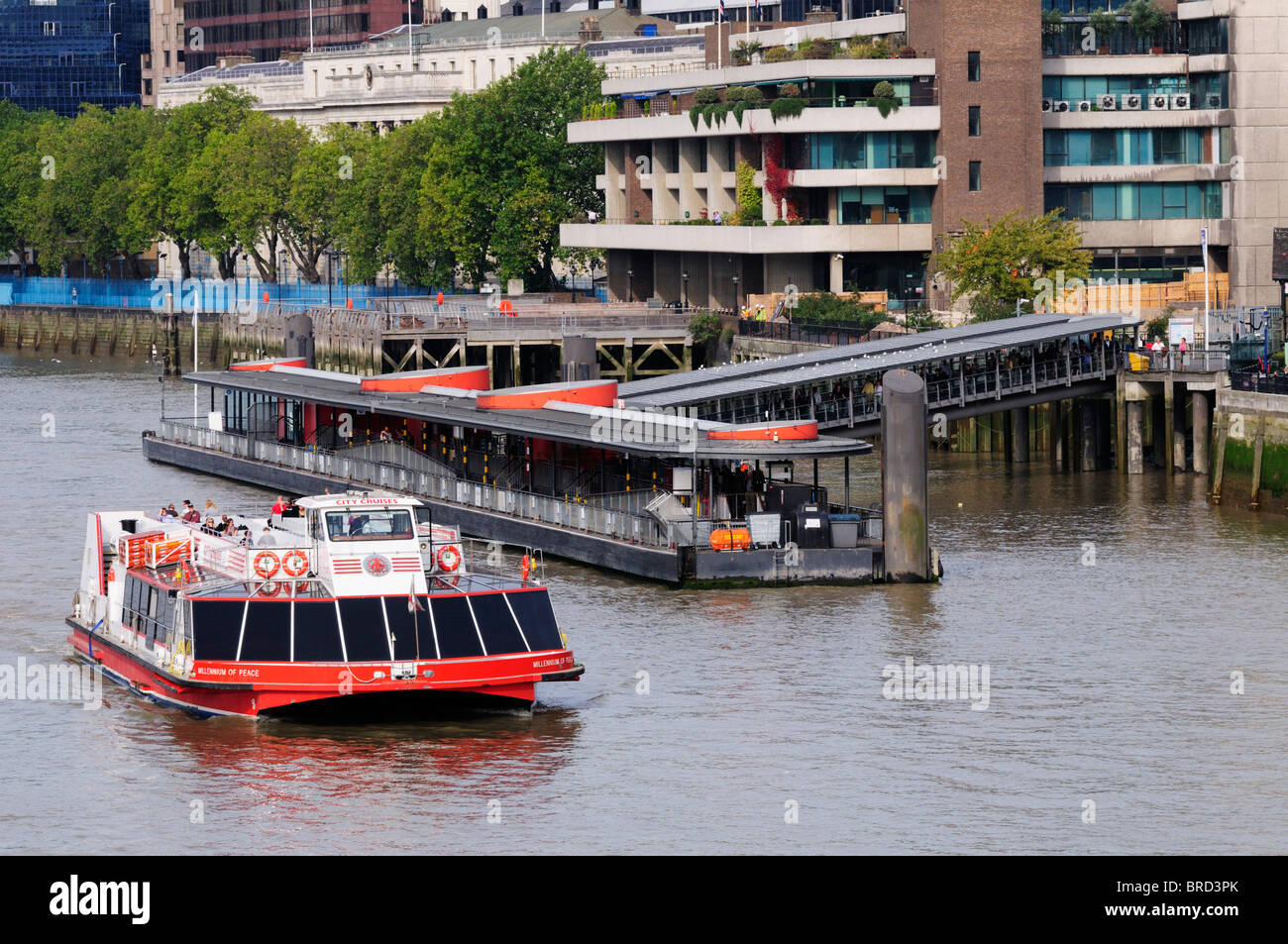 A City Cruises River Thames sightseeing tourist cruise boat at Tower Pier, London, England, UK - Stock Image