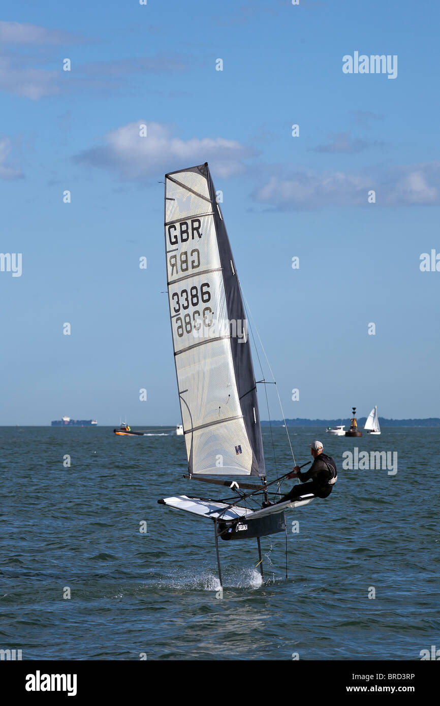 Foiling Sailing Dinghy Hydrofoil Moth Fast Speed in 10kts of wind - Stock Image