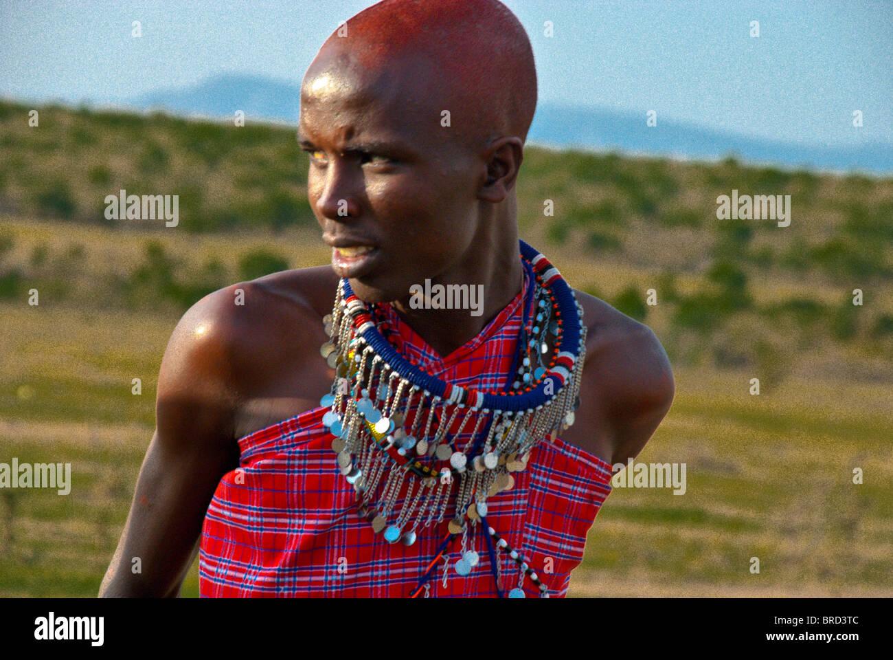 Masai woman wearing traditional dress, Masai Mara, Kenya, Africa Stock Photo