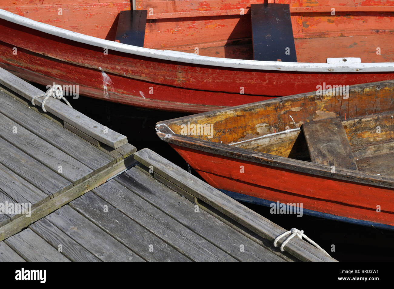 Colorful rowboats on dock in Rockport Harbor, Massachusetts - Stock Image
