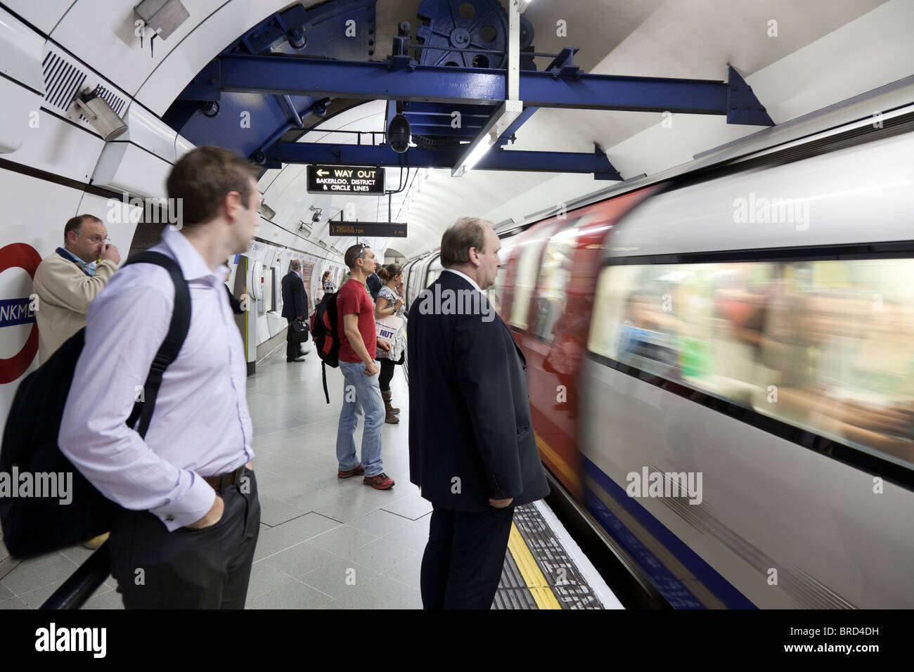 waiting for the tube train at London Underground - Stock Image