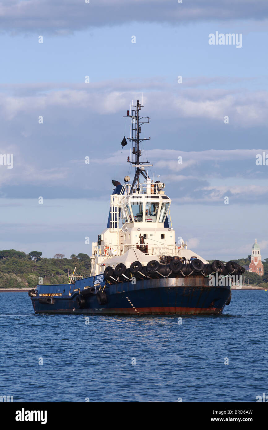 Black and cream tug boat Southampton Water - Stock Image