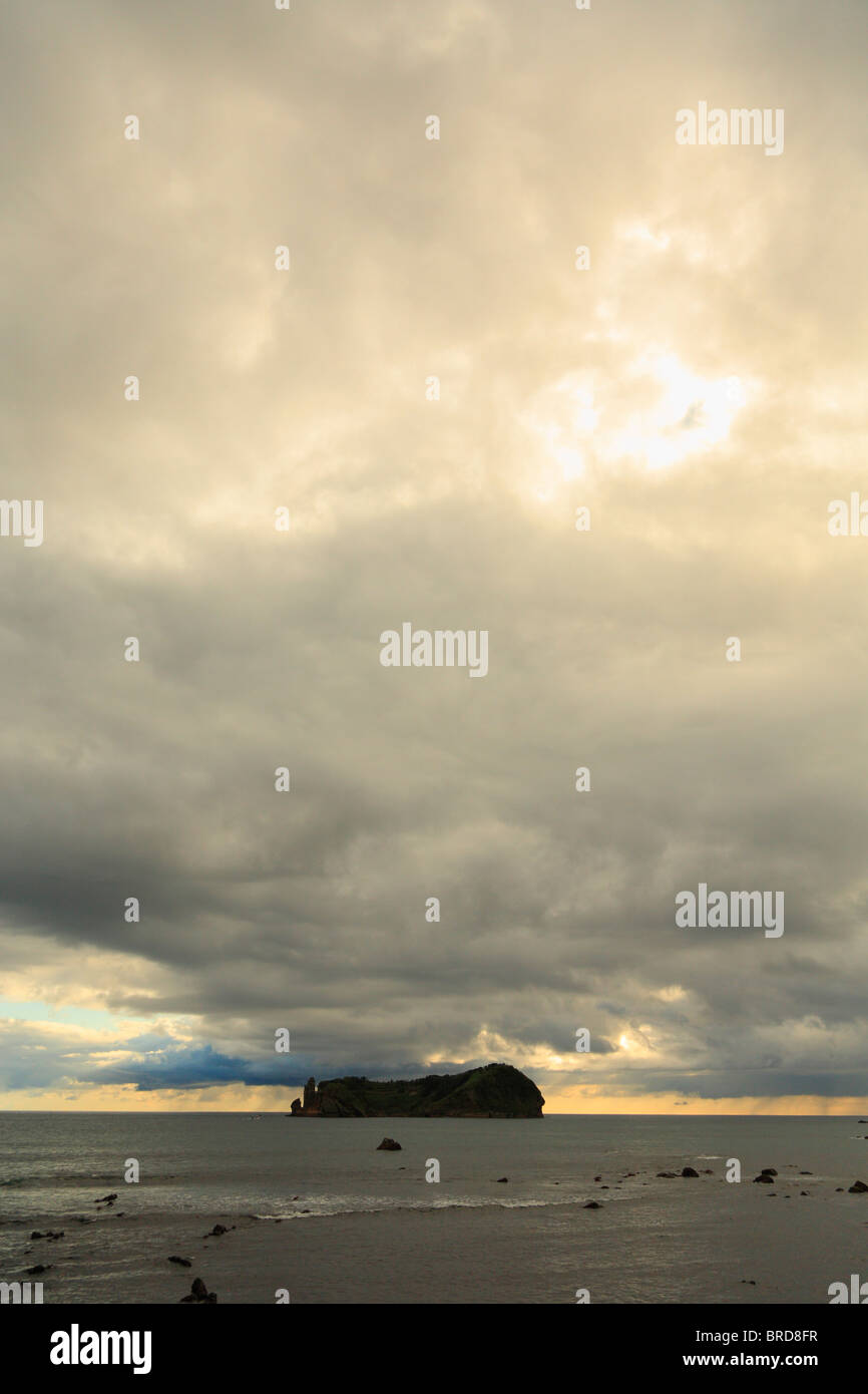 The islet of Vila Franca do Campo, off the coast of Sao Miguel island, under an overcast sky. Azores, Portugal. - Stock Image