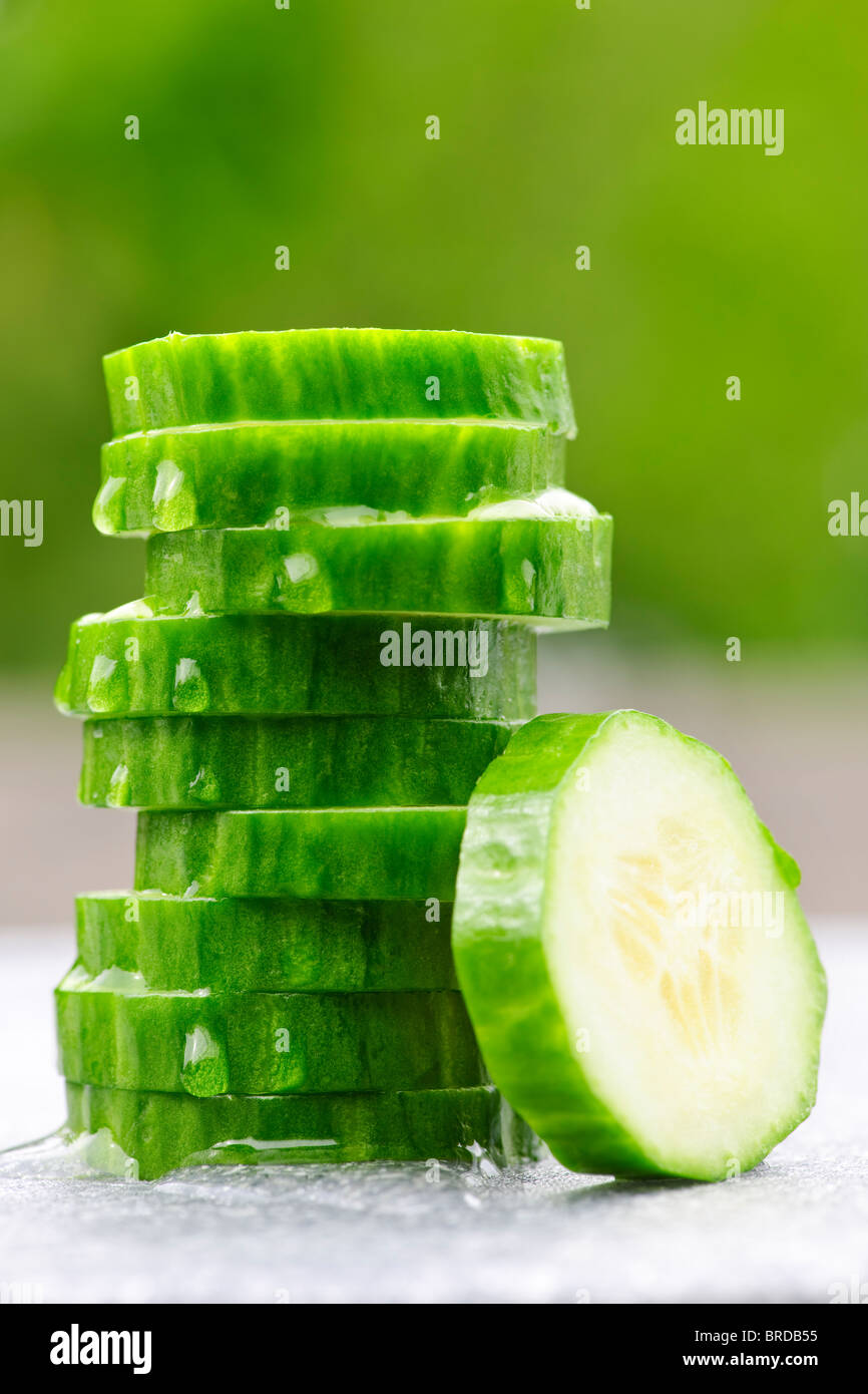 Stack of fresh organic green cucumber slices - Stock Image