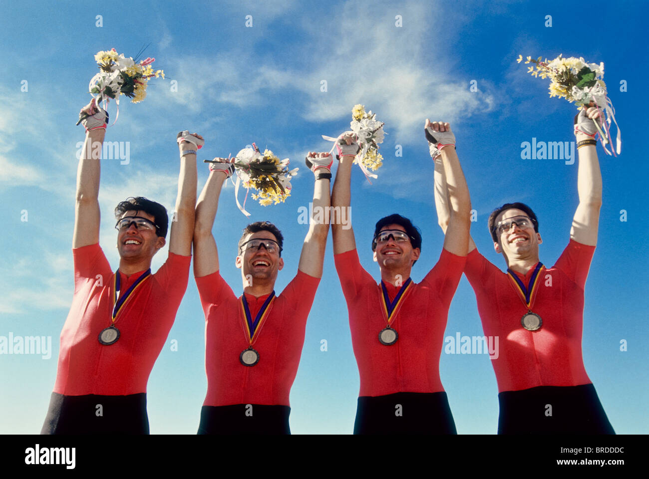 Mens cycling team on the podium with their gold medals. - Stock Image