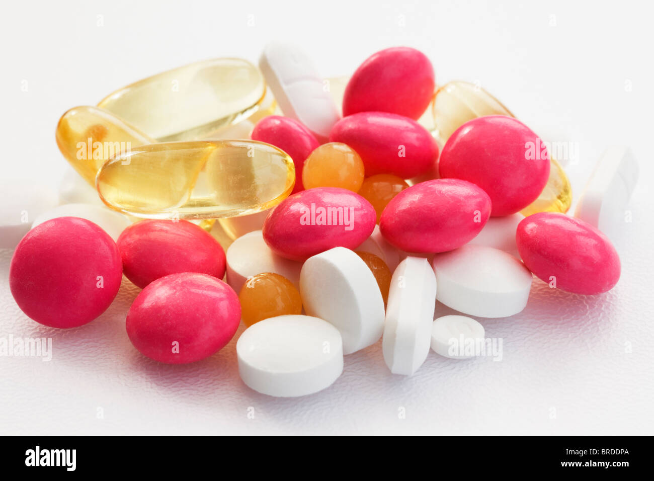 Close-up of an assortment of pills on a white background - Stock Image