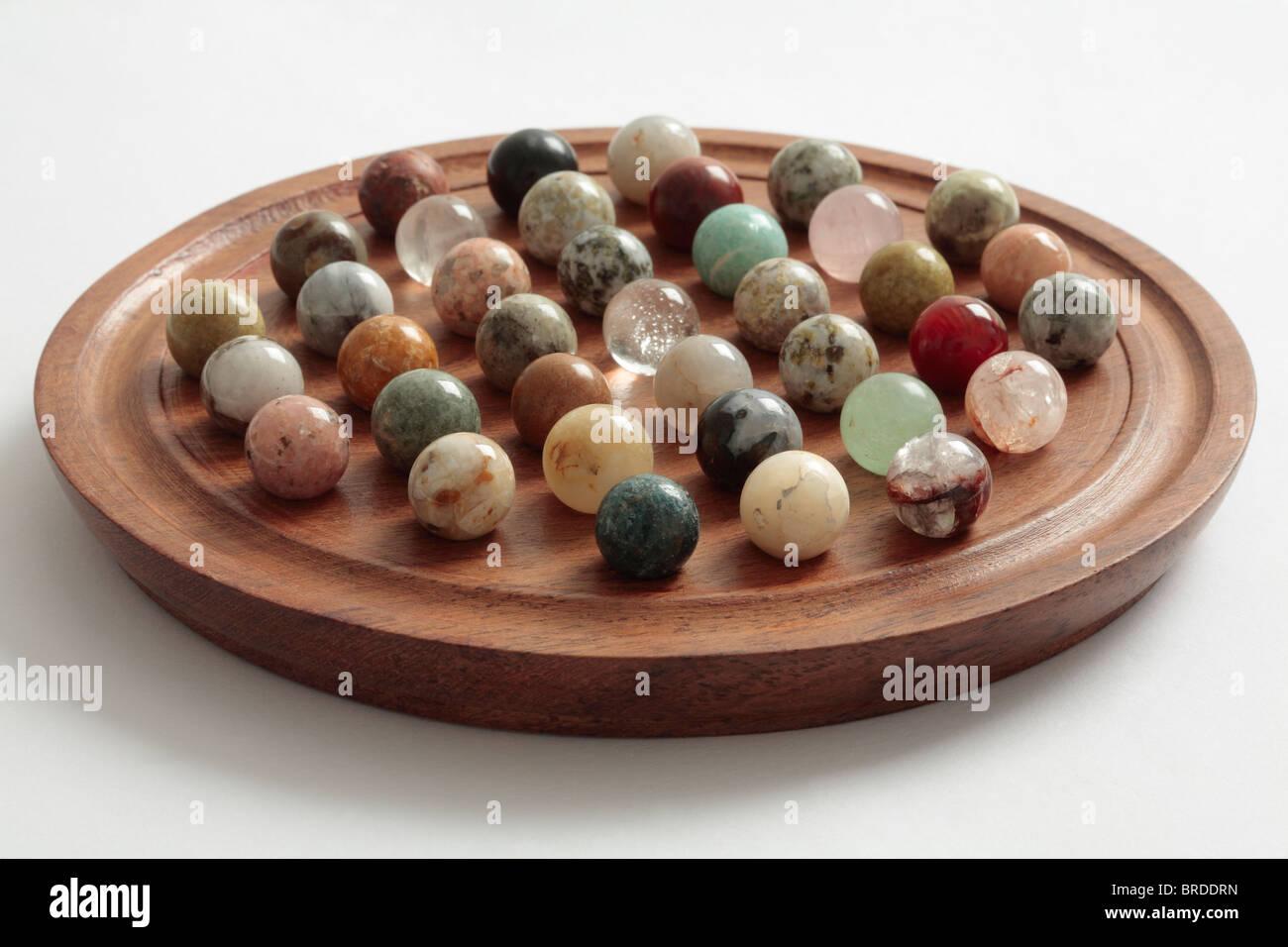 Solitaire Board with Semi-Precious Stone Balls. - Stock Image