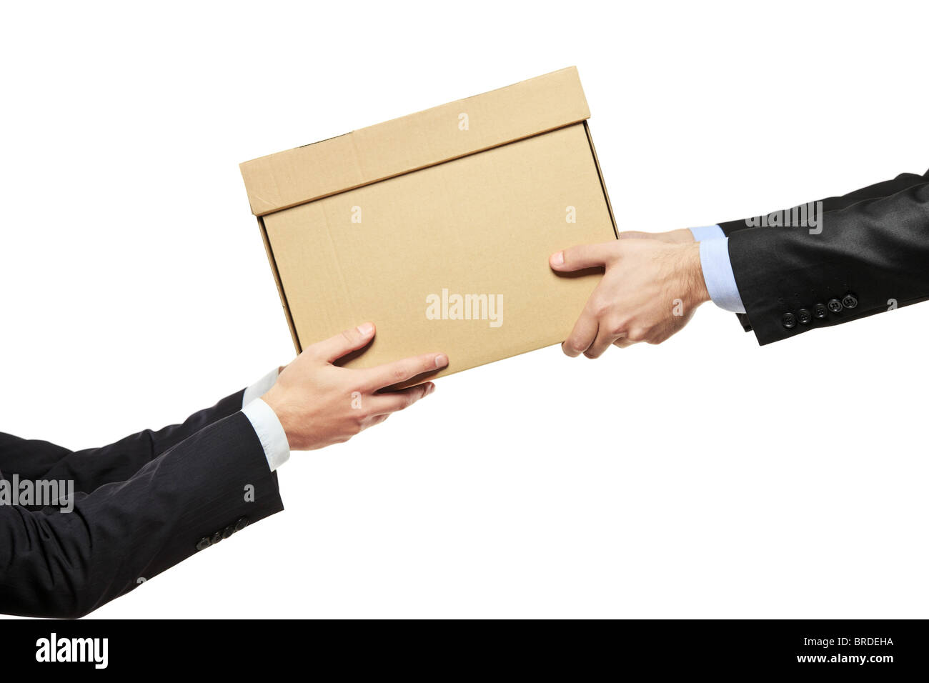 A businessman delivering a package to a man isolated on white - Stock Image