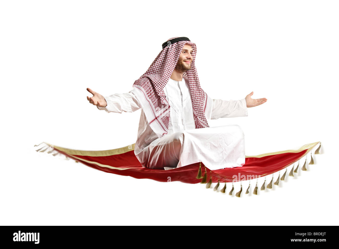 An arab person sitting on a flying carpet isolated on white Stock Photo