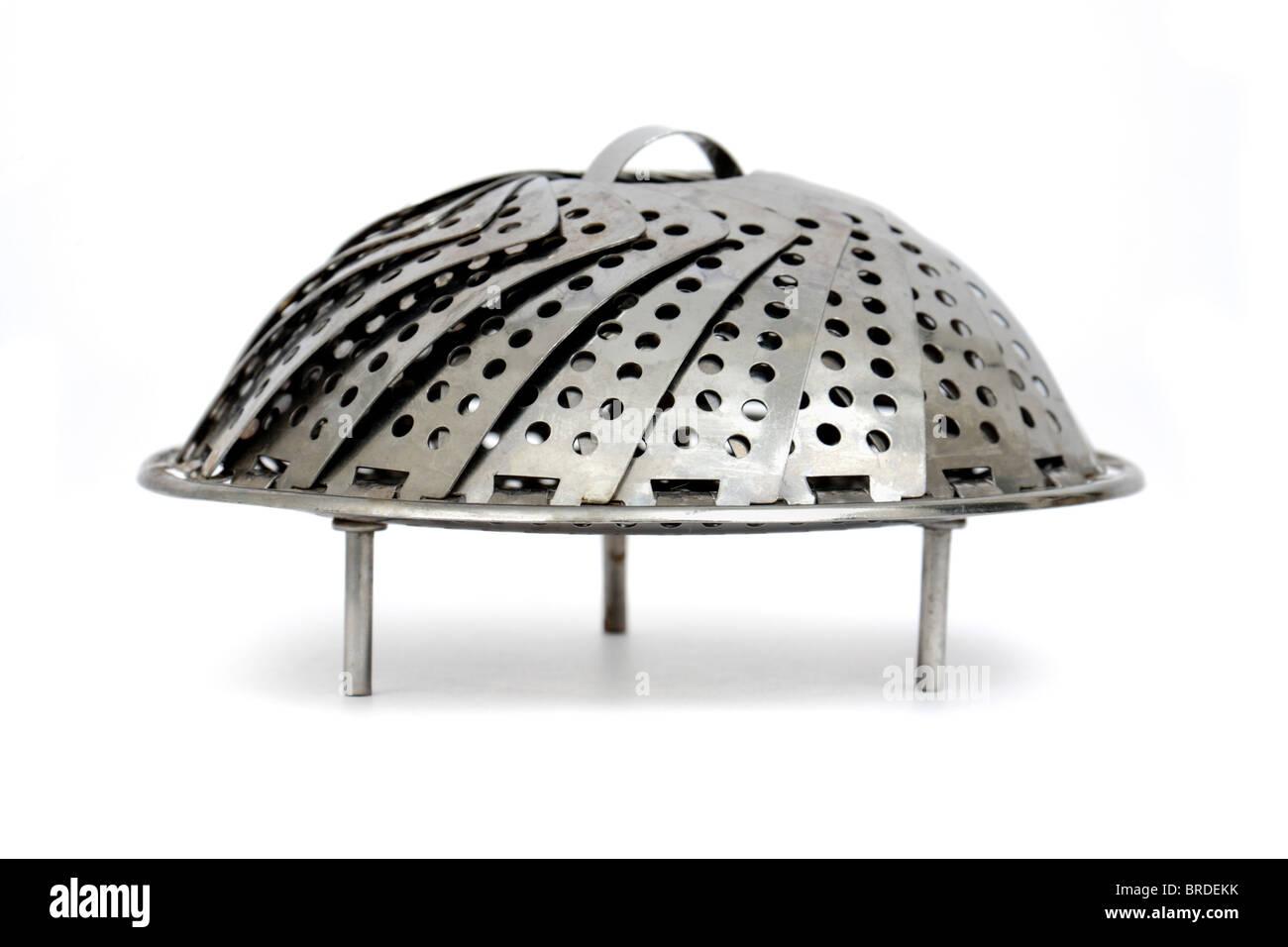 Vintage stainless steel folding spiral vegetable steamer (closed) - Stock Image