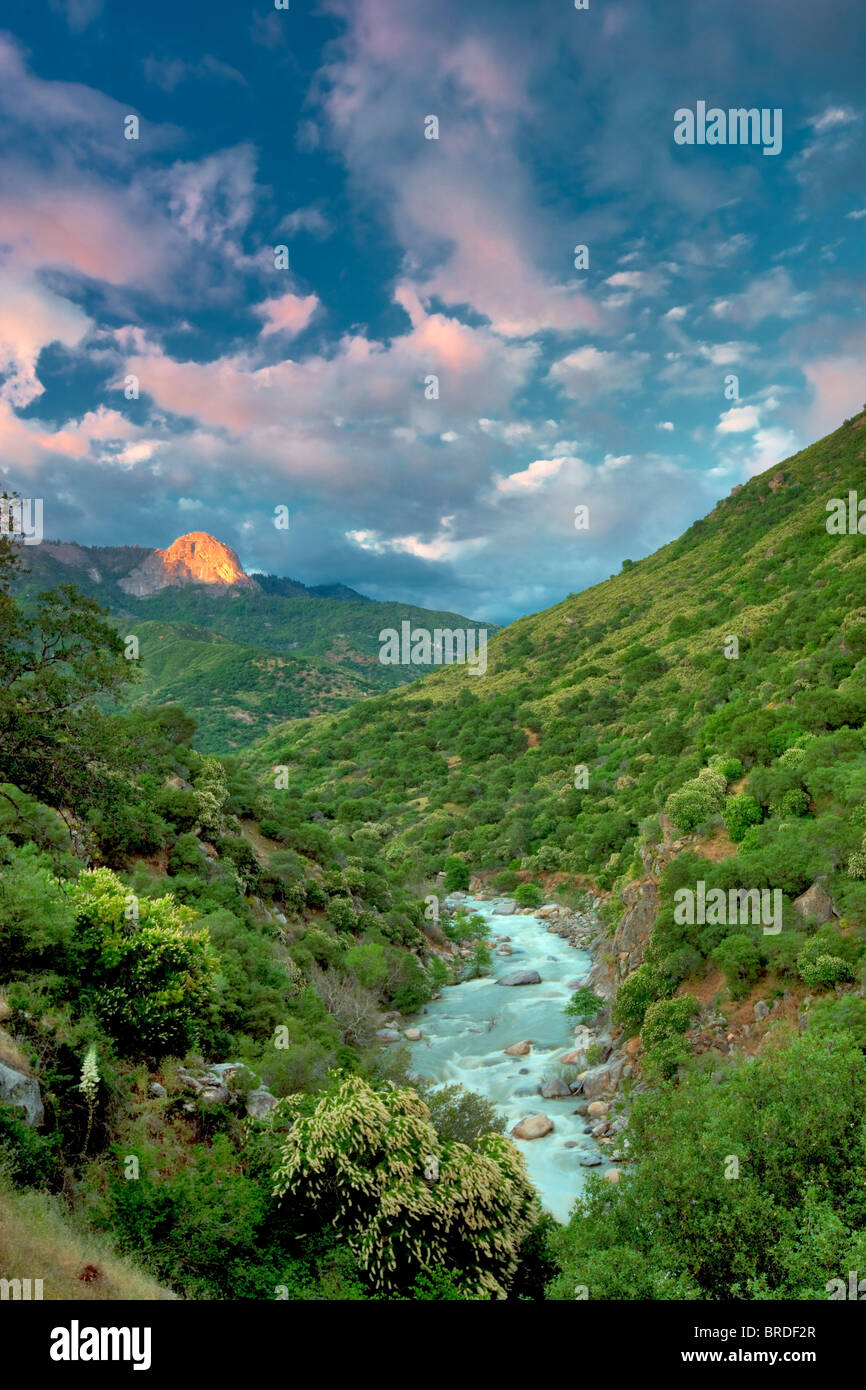 Sunset clouds and Middle Fork Kaweah River and sunlit Moro Rock. Sequoia National Park, California - Stock Image
