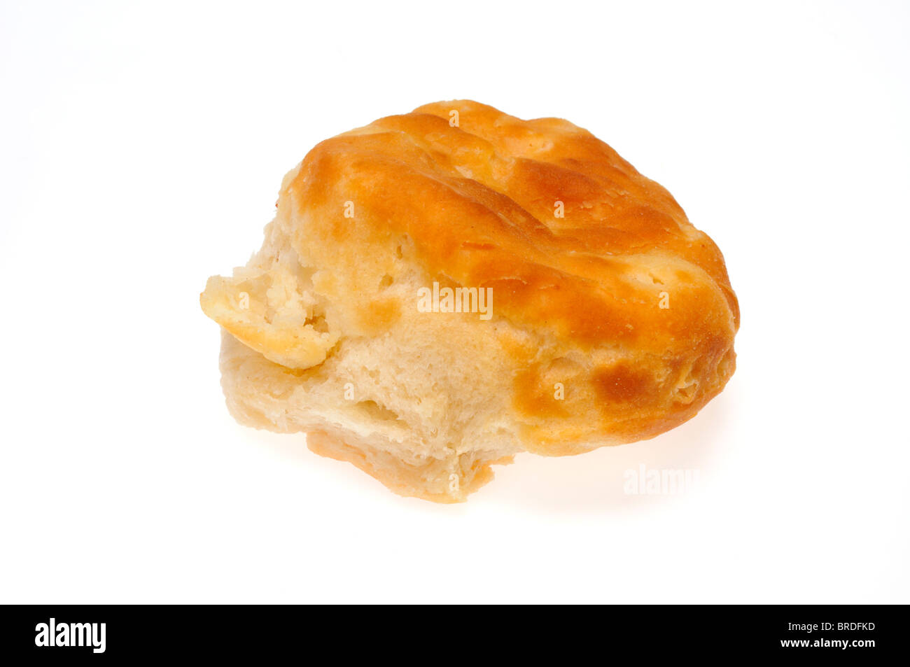 Single kfc baked, flaky buttermilk biscuit on white background, cutout. - Stock Image