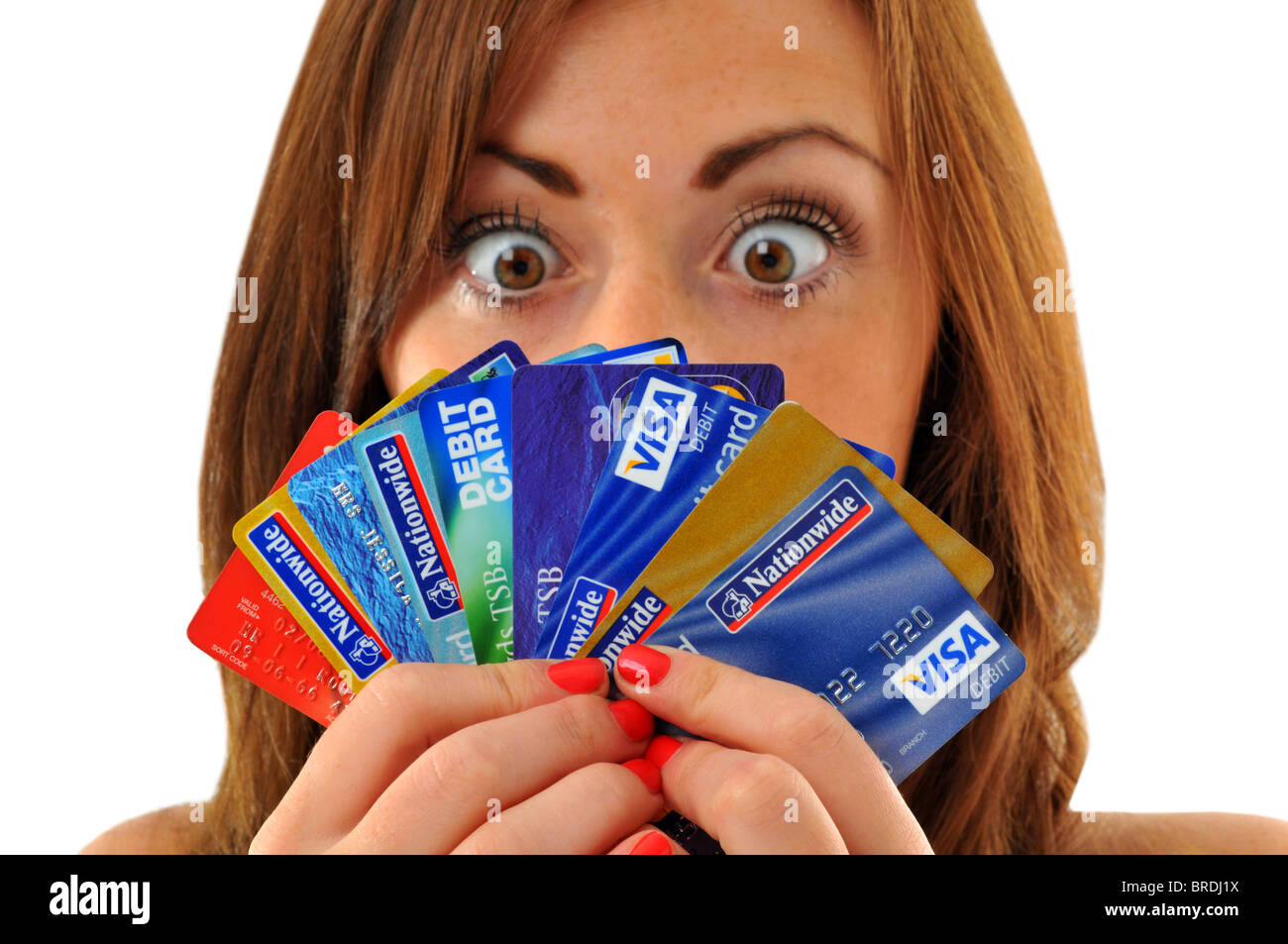 Credit cards, woman holding lots of credit and debit cards - Stock Image