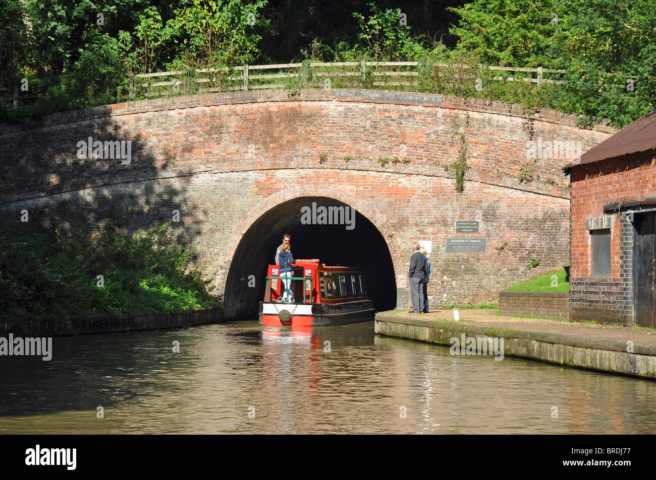 Barge enters the Blisworth Tunnel on the Grand Union Canal near Stoke Bruerne - Stock Image