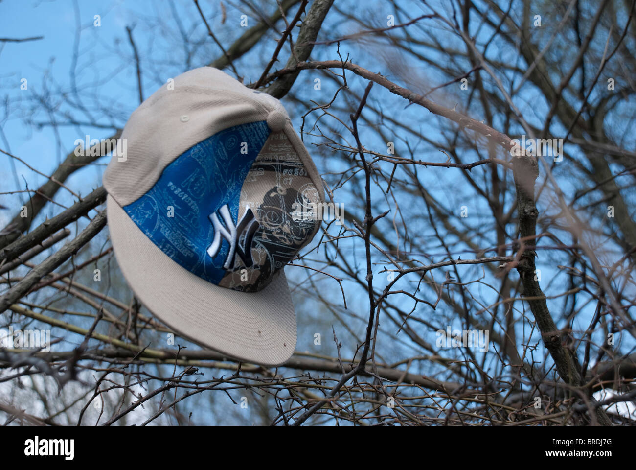 Lonely baseball cap - Stock Image