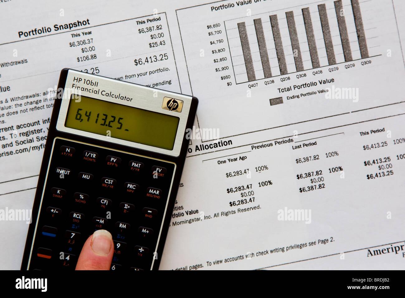 Calculator calculating investment, investment portfolio - Stock Image