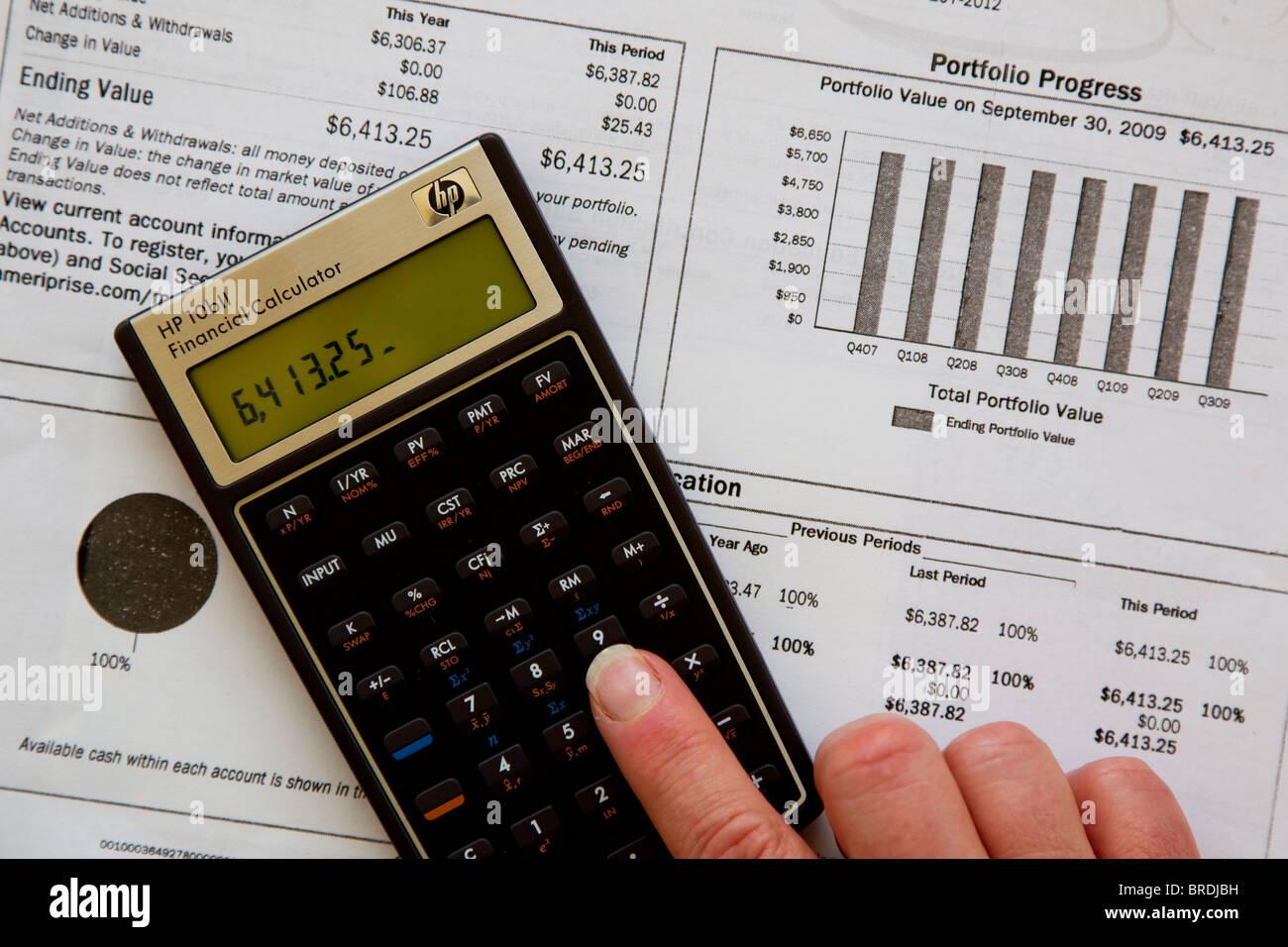 Calculator calculating investment income, investment portfolio - Stock Image