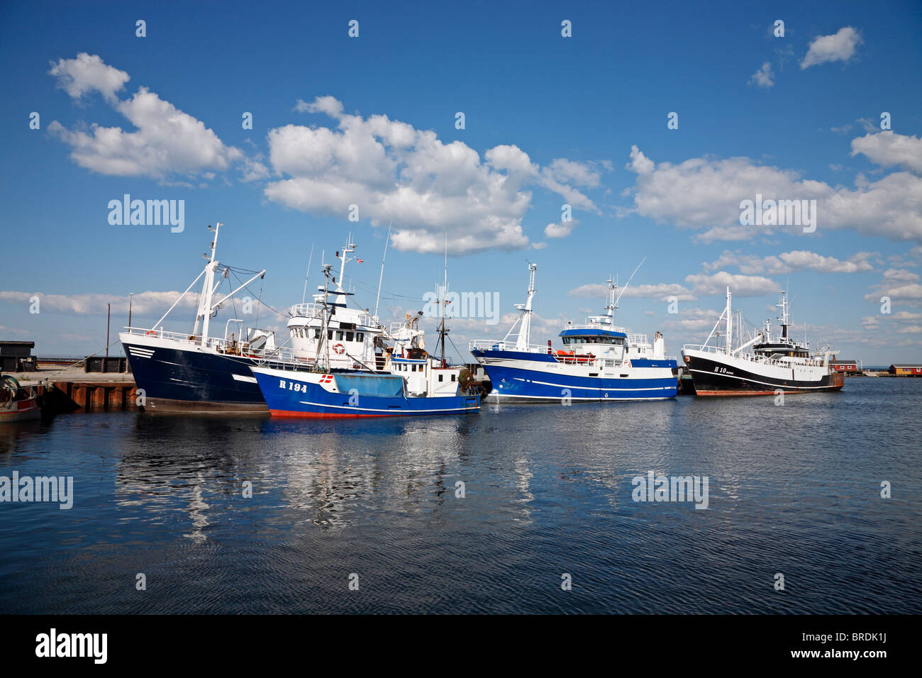 Part of the fishing fleet in the Danish harbour Gilleleje on the north coast of Zealand, Denmark - Stock Image