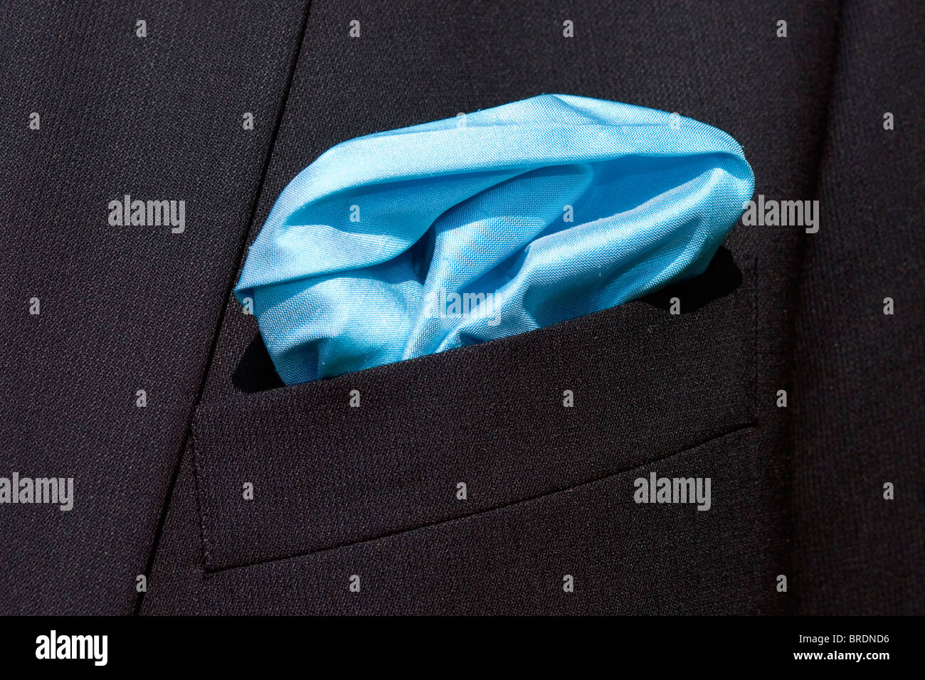 Blue handkerchief  in the pocket of the jacket worn on the day of the wedding. - Stock Image