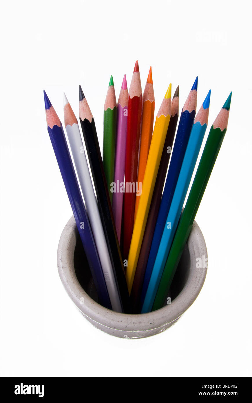 Coloured pencils standing in a pot. - Stock Image