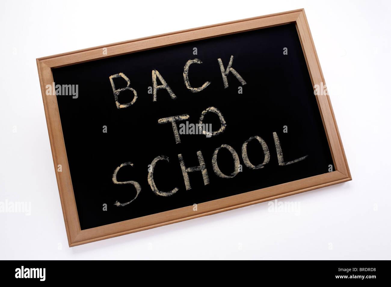 Back to School written in chalk on blackboard slate - Stock Image