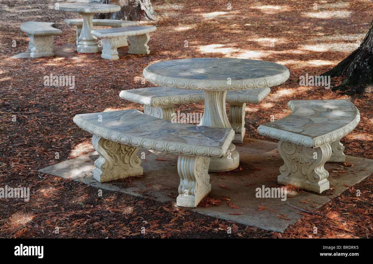 Concrete And Stone Round Picnic Tables In A Wooded Grove Stock Photo - Stone picnic table