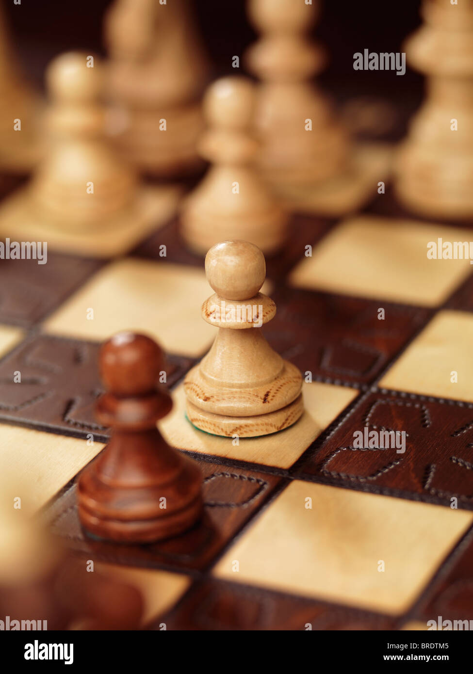 Two pawns on a chessboard - Stock Image