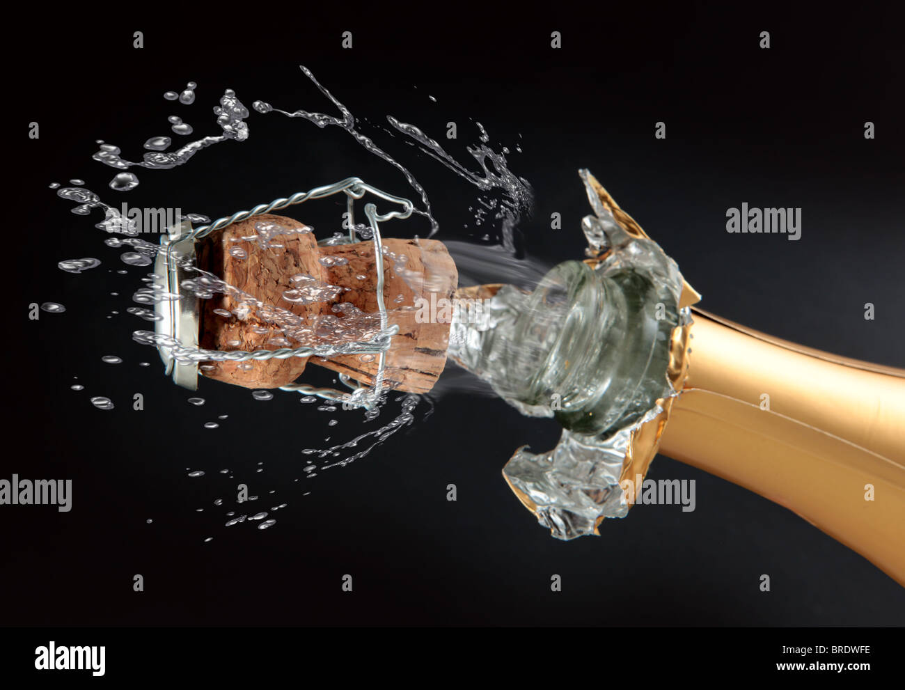 Champagne bottle cork popping - Stock Image