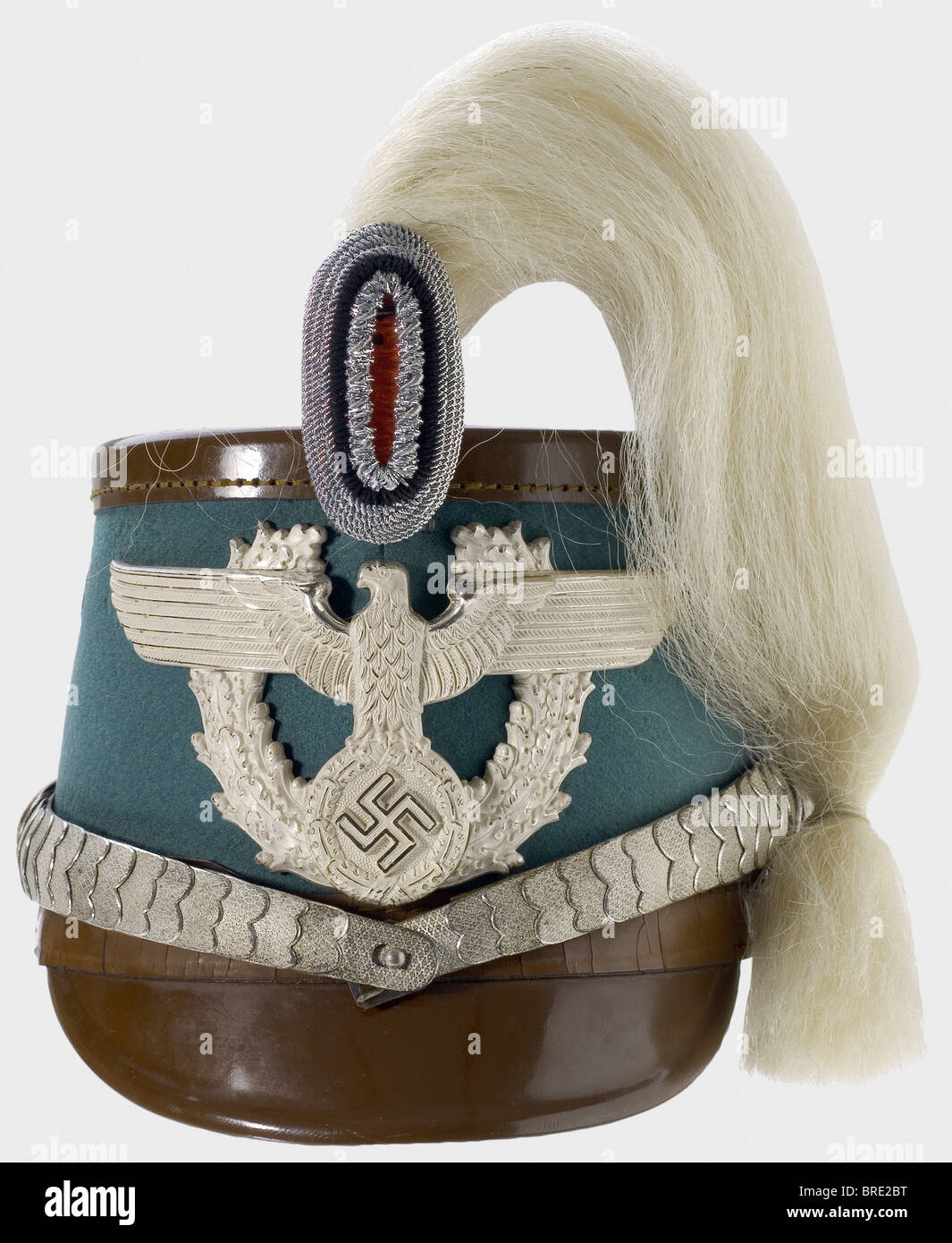A gendarmerie officer's shako, complete with parade plume and protective cover Fiberglass skull with police - Stock Image