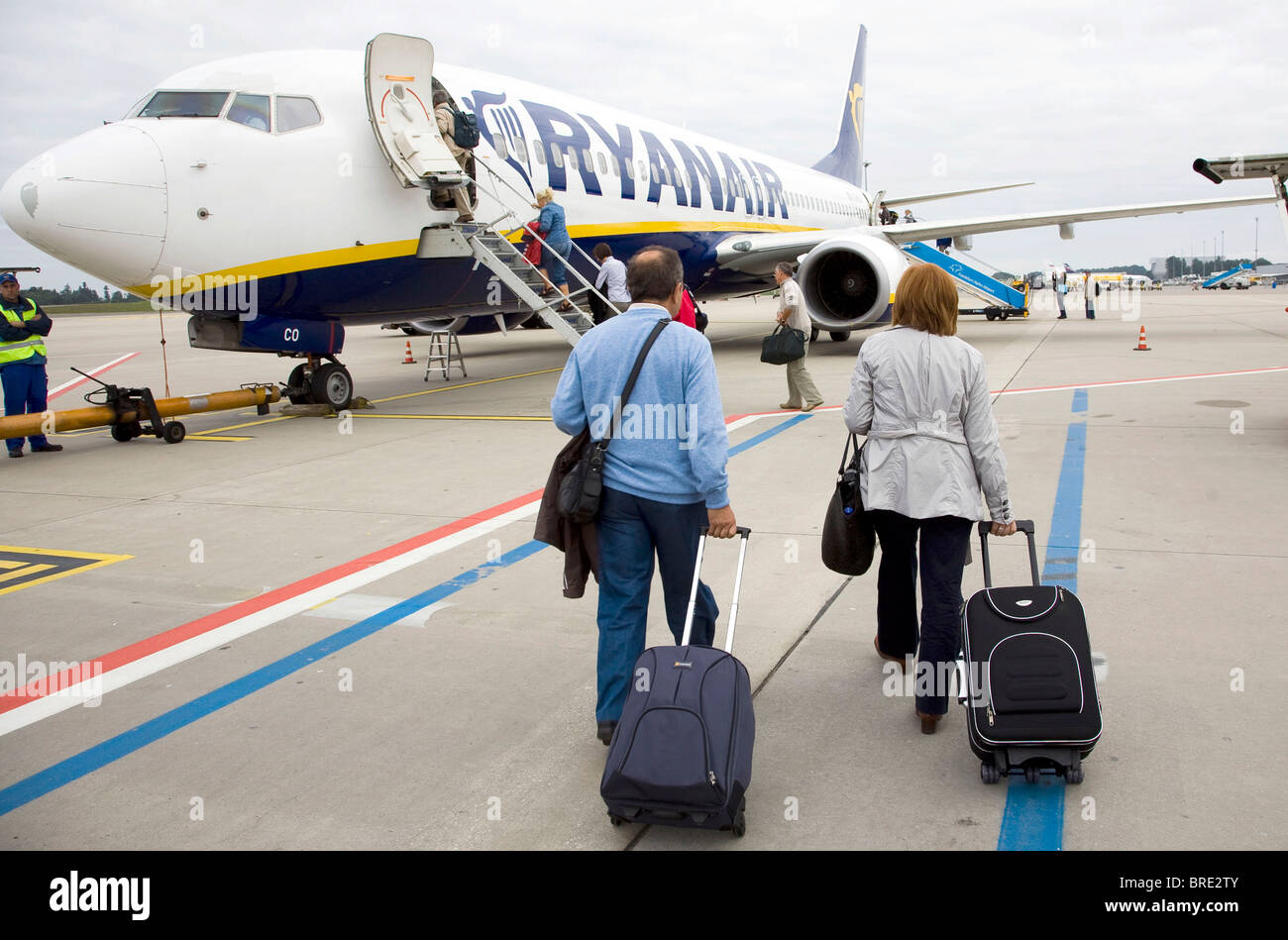 Passengers boarding a Boeing 737 of the low cost airline Ryanair at Frankfurt-Hahn Airport, Hahn Airport - Stock Image