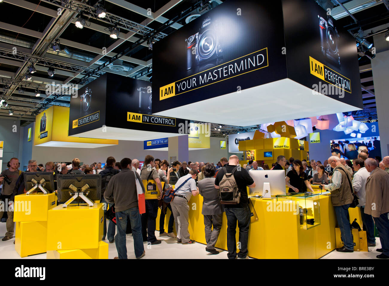 Many people at Nikon stand at Photokina digital imaging trade show in Cologne Germany - Stock Image