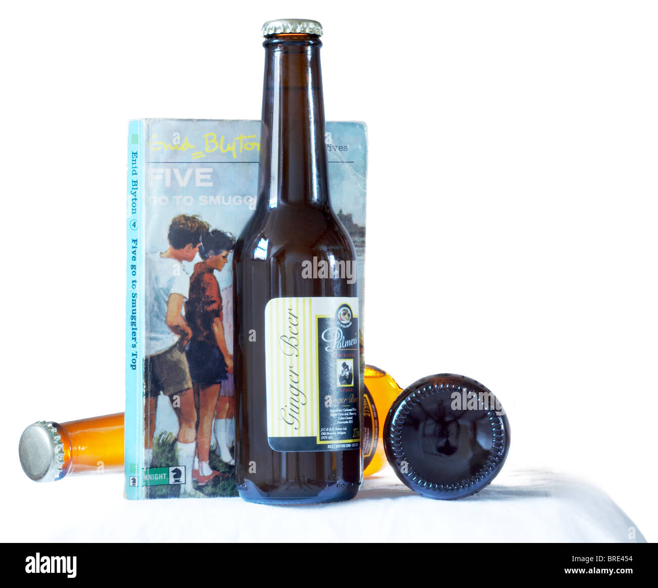 Bottles of ginger beer and a Famous Five book written by Enid Blyton - Stock Image