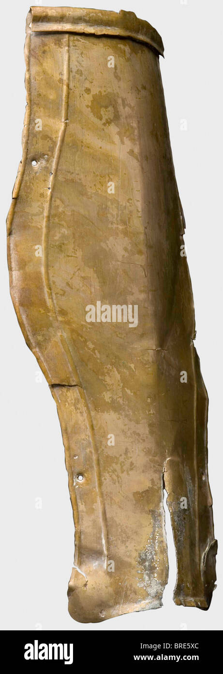 A Roman greave with inscription, 2nd/3rd century A.D. Embossed brass. Sparsely decorated greave with a slightly - Stock Image