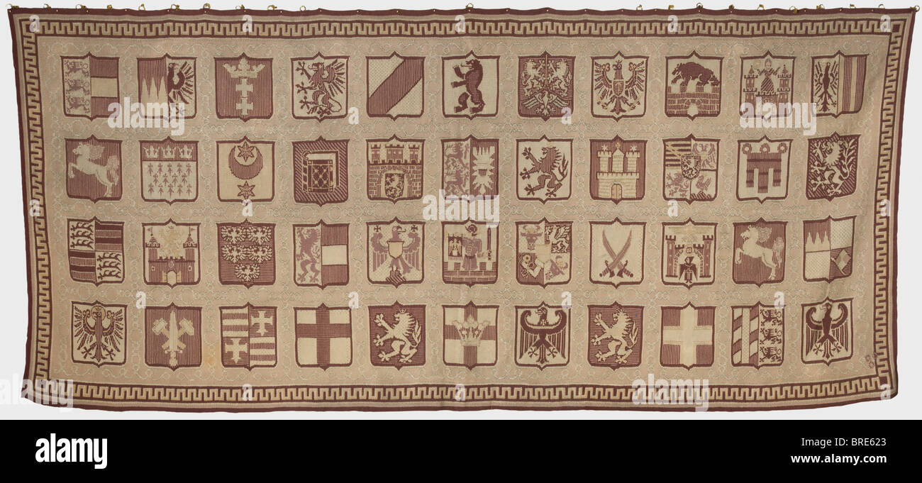 A wall tapestry, with the 44 coats of arms for the NS-Gaue In brown shades of hand-woven wool, interwoven with silver - Stock Image