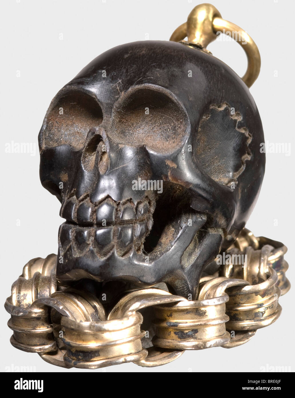 A German miniature memento-mori skull, 17th century A small, delicately carved skull of dark horn. There is a fire Stock Photo