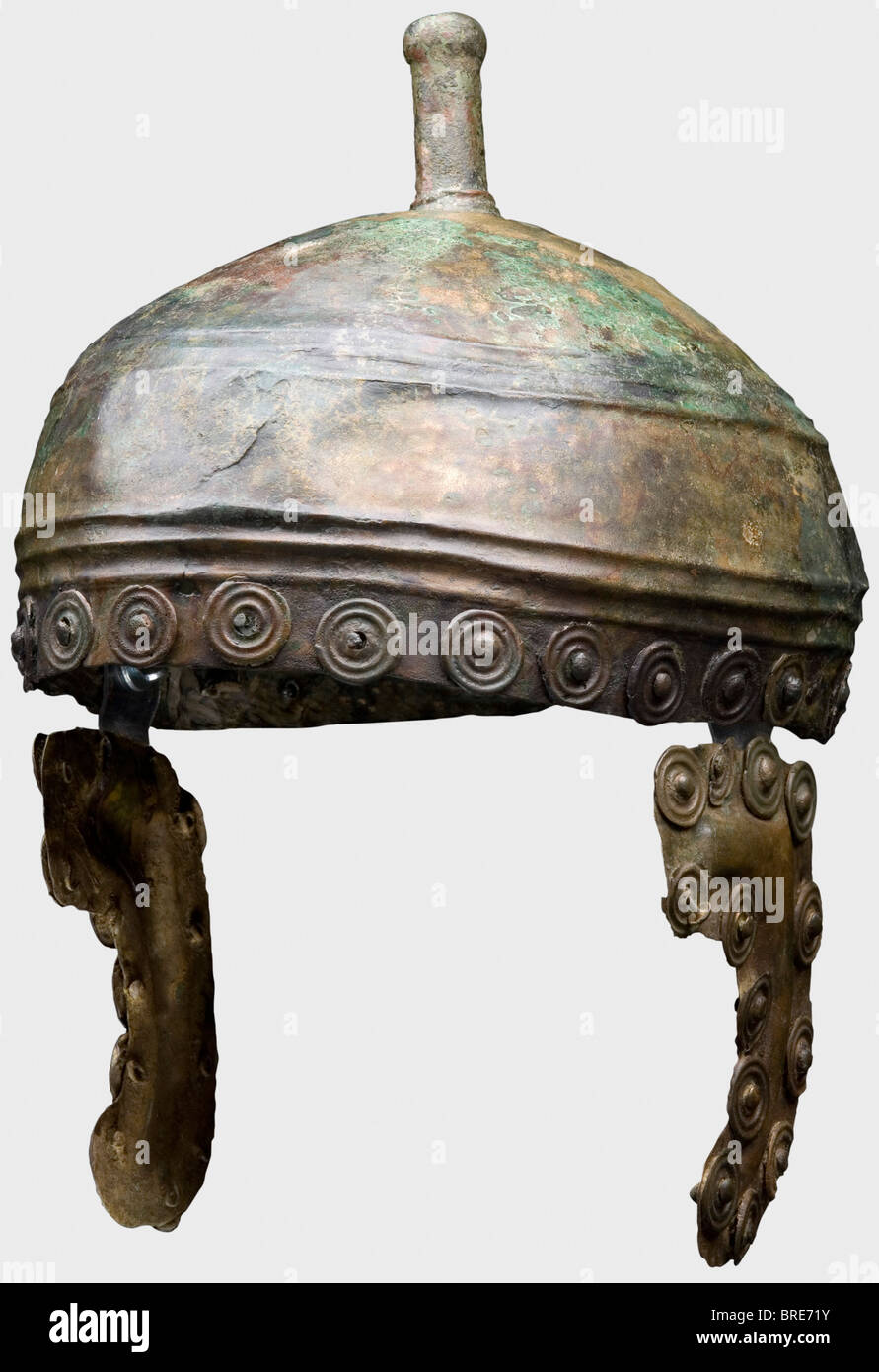 A Bronze Age helmet, 13th/12th century B.C. Shallow bronze skull with two bands of triple ridges and a cast-on helmet - Stock Image