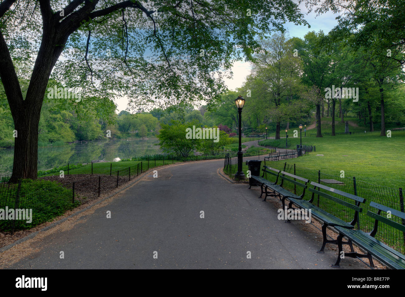 Early morning on the sidewalk in Central Park Stock Photo