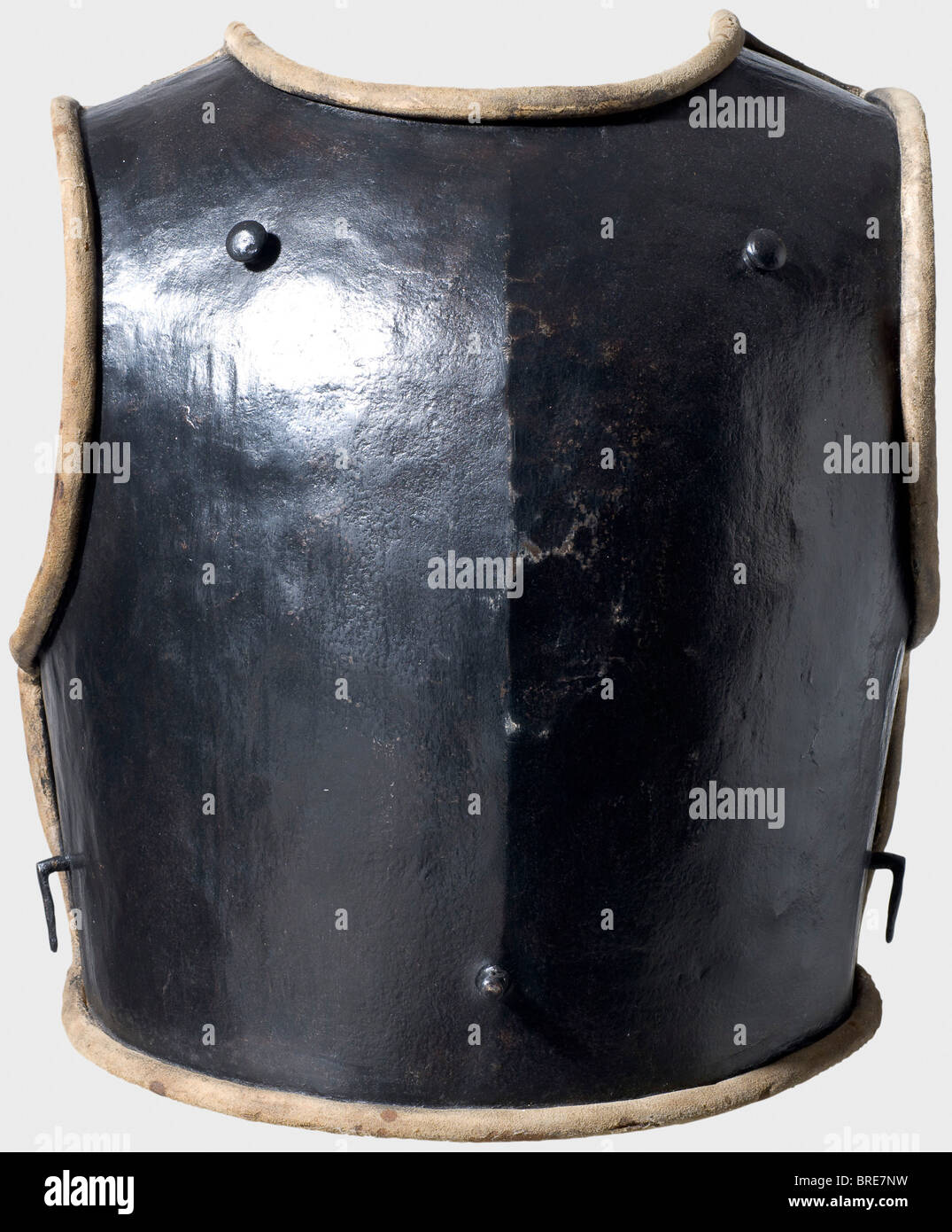 A Prussian enlisted man's cuirass, before 1740 A heavy, blackened breastplate with a slight central ridge. Pegs - Stock Image