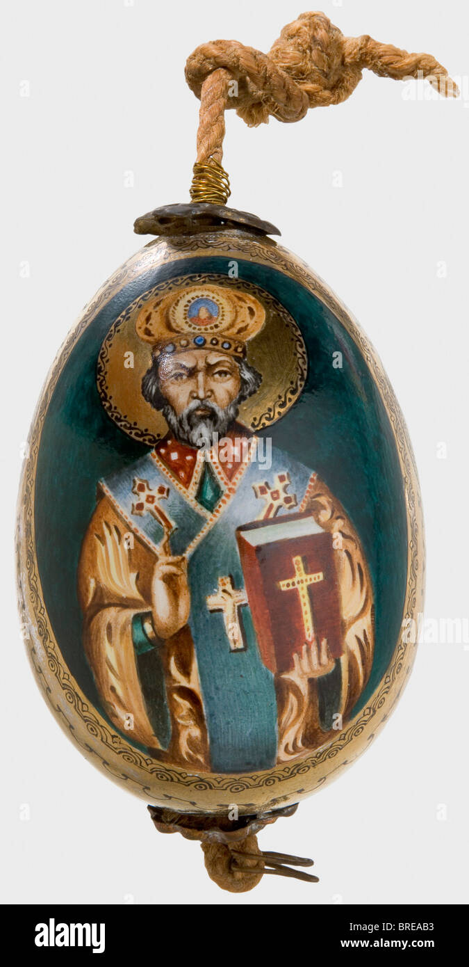 A painted easter egg, Russia, after 1900 Ceramic(?). Hand-painted depictions of the Virgin Mary and St. Nicholas - Stock Image