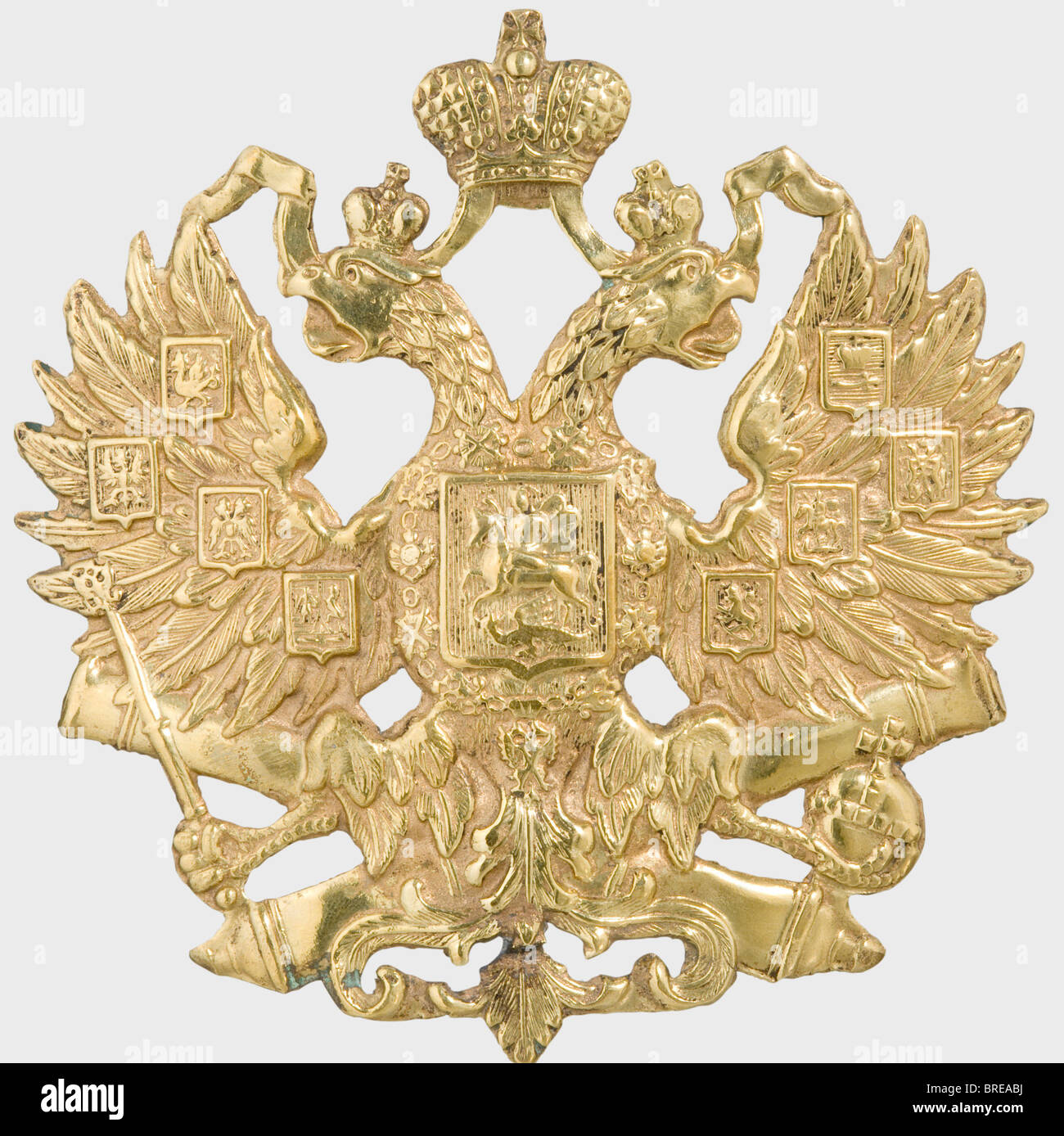 A helmet emblem, of the Imperial Russian Army Sheet brass with the gilding mostly preserved. The loops on the back - Stock Image